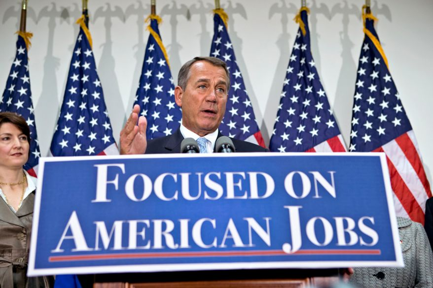 House Speaker John A. Boehner, Ohio Republican, accompanied by Rep. Cathy McMorris Rodgers (left), Washington Republican, and other members of House GOP leadership, gestures as he speaks to reporters on Capitol Hill in Washington on Wednesday, Nov. 28, 2012. (AP Photo/J. Scott Applewhite)