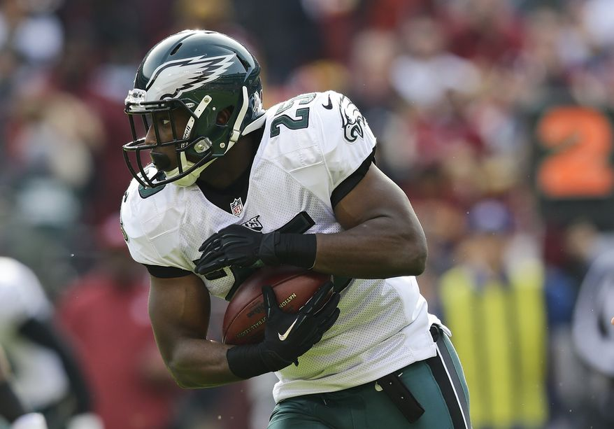 Philadelphia Eagles' LeSean McCoy carries the ball during the first half of an NFL football game against the Washington Redskins in Landover, Md., Sunday, Nov. 18, 2012. (AP Photo/Alex Brandon)