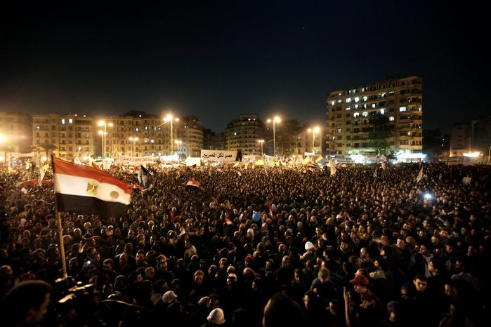 Egyptians chant slogans during a demonstration in Tahrir Square in Cairo on Tuesday, Nov. 27, 2012. More than 200,000 people chanted against Egypt's Islamist president in a powerful show of strength by the opposition, demanding that President Mohammed Morsi revoke edicts granting himself near-autocratic powers. (AP Photo/Nariman El-Mofty)