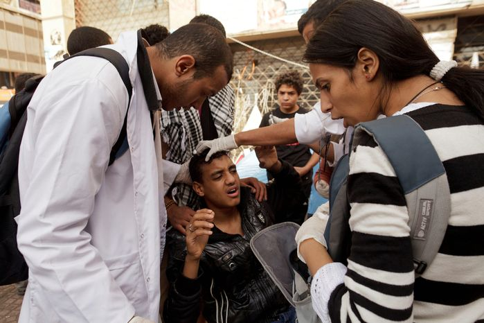 An Egyptian protester is treated at a field hospital in Tahrir Square in Cairo for wounds sustained during clashes with security forces on Thursday, Nov. 29, 2012. (AP Photo/Maya Alleruzzo)