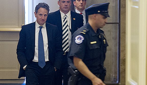 "Treasury Secretary Timothy F. Geithner (left) enters the U.S. Capitol in Washington on Thursday, Nov. 29, 2012, to meet with House and Senate leaders to discuss the looming ""fiscal cliff."" (Barbara L. Salisbury/The Washington Times)"