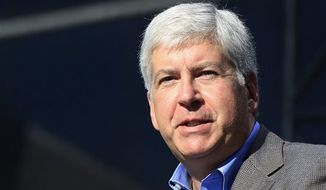 ** FILE ** In this Sept. 10, 2012, photo Michigan Gov. Rick Snyder speaks in Flat Rock, Mich. (AP Photo/Carlos Osorio, File)
