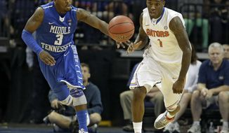 Florida guard Kenny Boynton (1) outruns Middle Tennessee guard James Gallman (3) to the ball during the second half of an NCAA college basketball game Sunday, Nov. 18, 2012, in XXX, Fla. (AP Photo/Chris O'Meara)