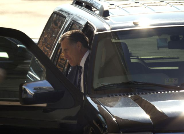 Former Republican presidential candidate Mitt Romney arrives at the White House in Washington on Thursday, Nov. 29, 2012, for a private luncheon with President Obama. (AP Photo/Pablo Martinez Monsivais)