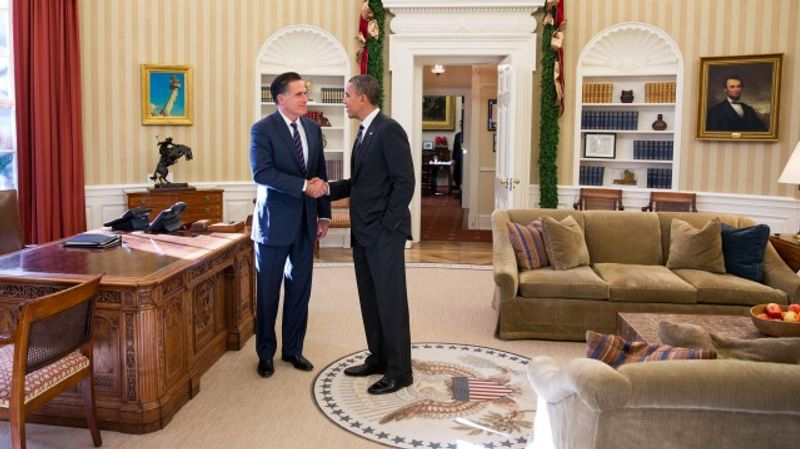 In this photo released by the White House, President Obama and Mitt Romney meet in the Oval Office before their private lunch on Thursday, Nov. 29, 2012.