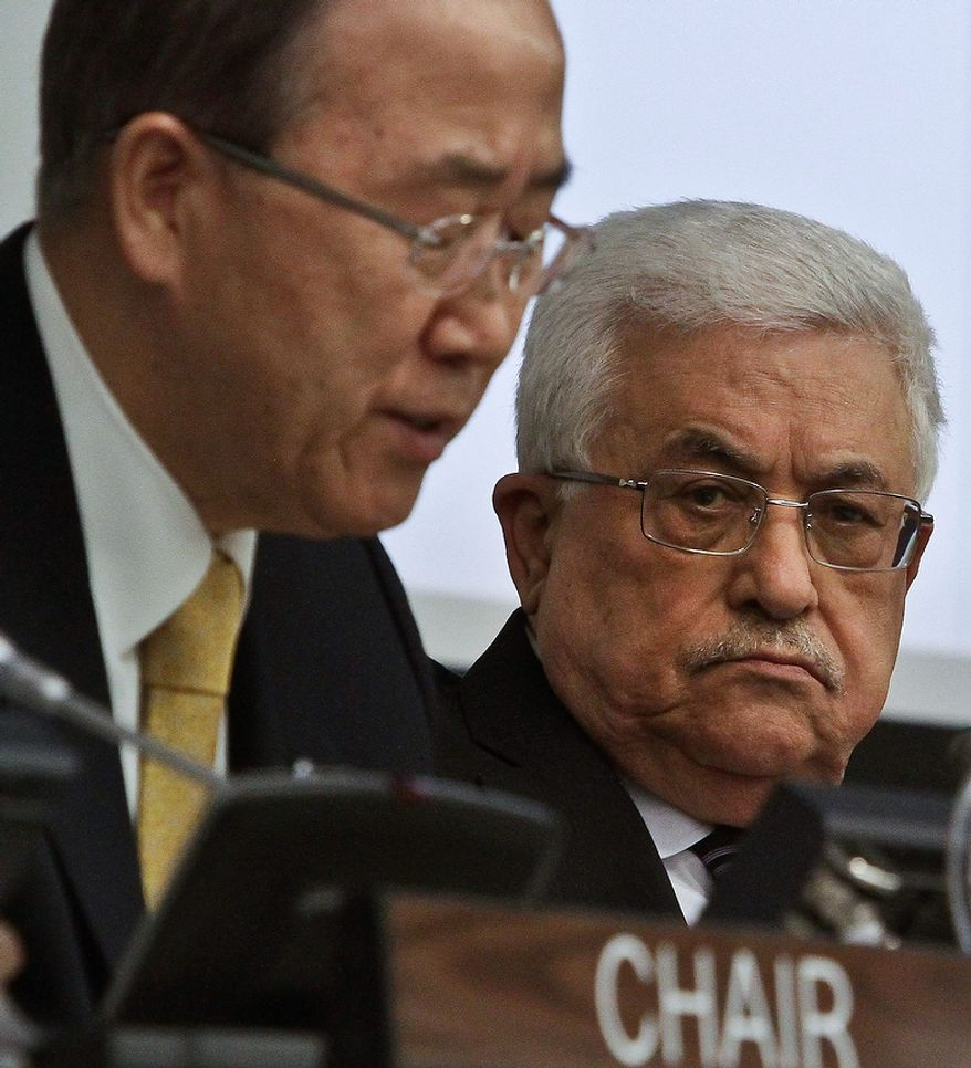 Palestinian President Mahmoud Abbas, right, listens as U.N. Secretary-General Ban Ki-moon speaks during a meeting on Palestine, Thursday, Nov. 29, 2012. Palestinians are expected to win U.N. recognition as a state, even as the U.S., Israel's closest ally, mounts an aggressive campaign to head off the General Assembly vote.  (AP Photo/Bebeto Matthews)