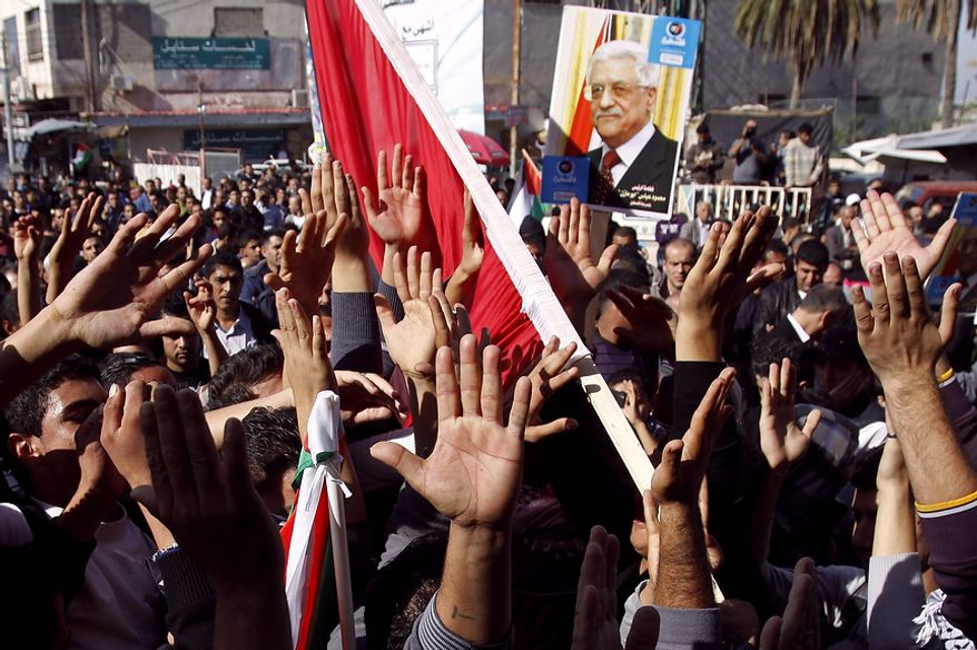 People march in support of the Palestinian UN bid for observer state status, in the West Bank town of Jenin, Thursday, Nov. 29, 2012. The Palestinians are certain to win U.N. recognition as a state on Thursday but success could exact a high price: delaying an independent state of Palestine because of Israel's vehement opposition. (AP Photo/Mohammed Ballas)