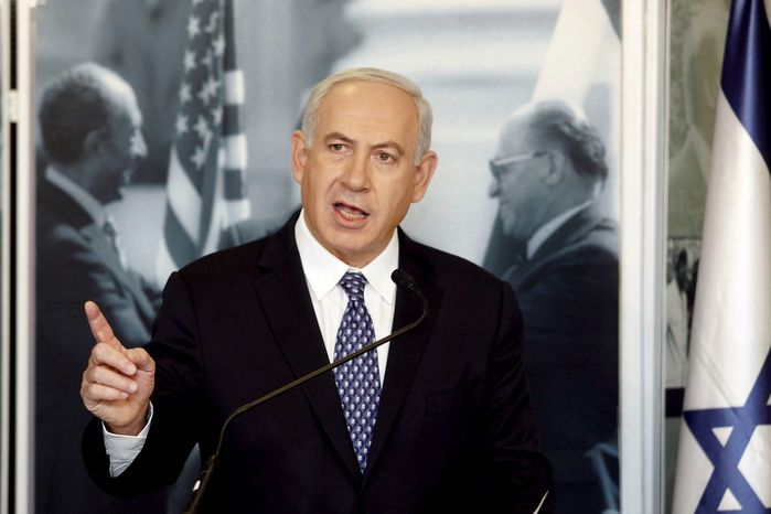 Israeli Prime Minister Benjamin Netanyahu delivers a statement to the press about the Palestinian bid before the United Nations during a visit to an exhibition marking 35 years since Egyptian President Anwar Sadat's visit to Israel, at the Menachem Begin Heritage Center in Jerusalem on Thursday, Nov. 29, 2012. (AP Photo/Gali Tibbon, Pool)