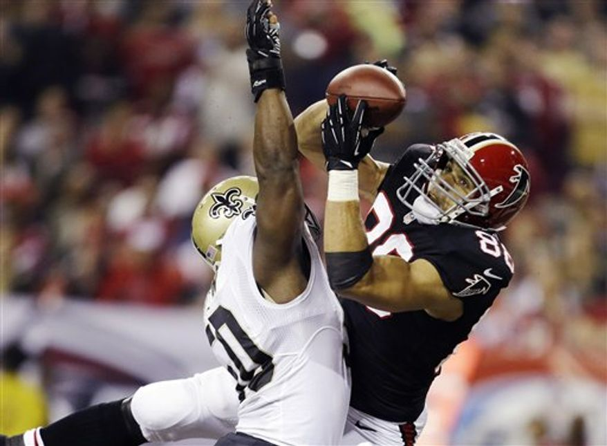 Atlanta Falcons tight end Tony Gonzalez (88) makes a catch for a touchdown as New Orleans Saints Saints middle linebacker Curtis Lofton (50) defends during the first half of an NFL game, Thursday, Nov. 29, 2012, in Atlanta. The Falcons won 23-13. (AP Photo/David Goldman)