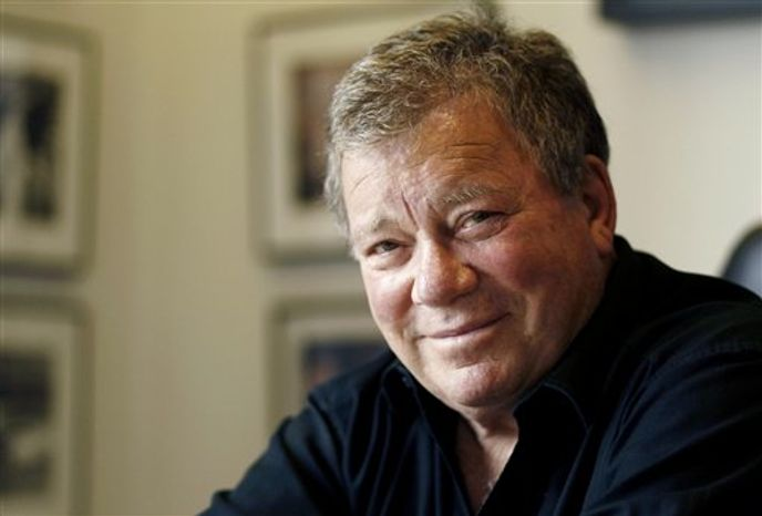 ** FILE ** In this Jan. 30, 2011, photo, actor William Shatner poses for a portrait in Los Angeles. Capt. James T. Kirk will be on hand when the aircraft carrier USS Enterprise is officially retired. A publicist for Shatner says the actor will attend the ship's inactivation ceremony Saturday, Dec. 1, 2012, at Naval Station Norfolk. (AP Photo/Matt Sayles)