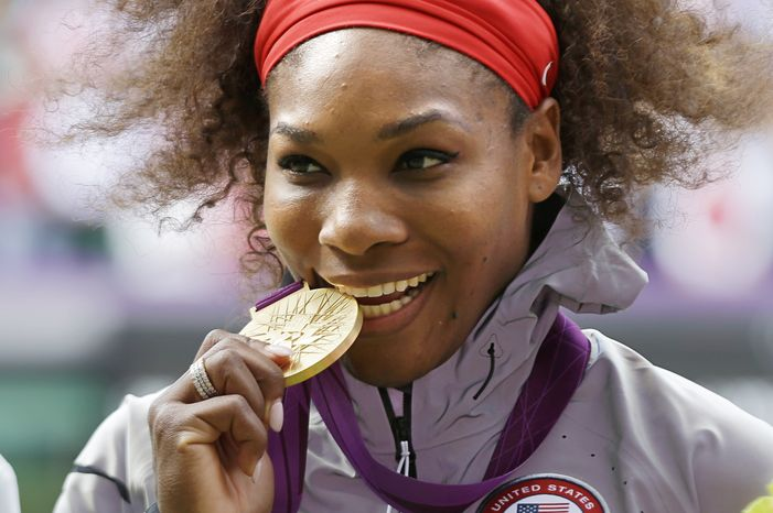 FILE - This Aug. 4, 2012 file photo shows Serena Williams posed with her 2012 Summer Olympics gold medal during the podium ceremony of the women's singles final match at the All England Lawn Tennis Club at Wimbledon, in London. Williams has been named the WTA's Player of the Year after winning major titles at Wimbledon and the U.S. Open, and claiming gold at the London Olympics. (AP Photo/Elise Amendola, File)