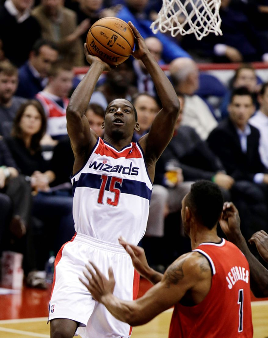 Washington Wizards guard Jordan Crawford shoots in front of Portland Trail Blazers forward Jared Jeffries during the second half of an NBA basketball game Wednesday, Nov. 28, 2012, in Washington. The Wizards won 84-82, their first victory of the season after 12 losses. (AP Photo/Alex Brandon)