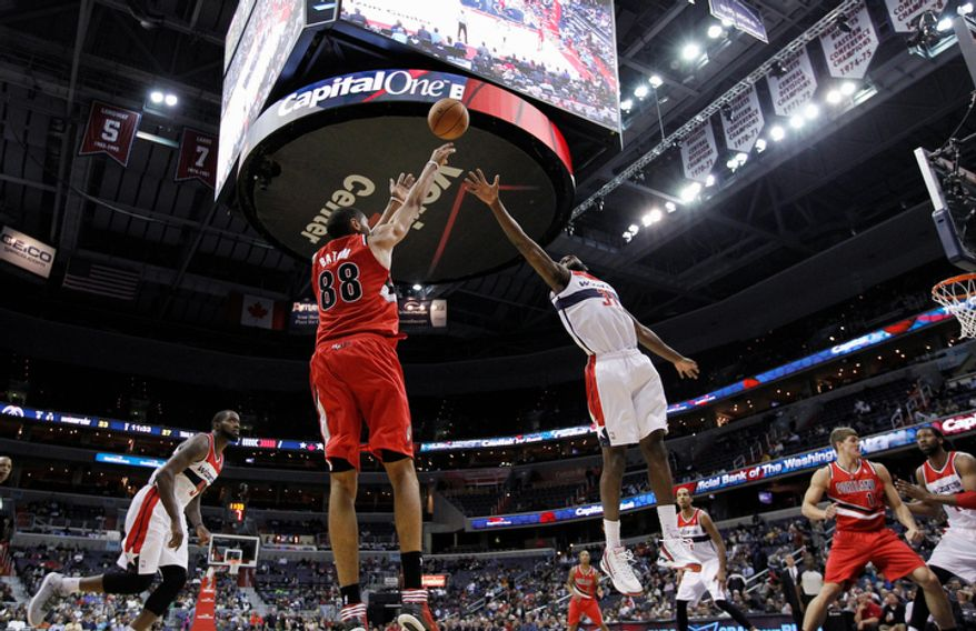 Portland Trail Blazers forward Nicolas Batum shoots over Washington Wizards forward Chris Singleton in the first half of an NBA basketball game Wednesday, Nov. 28, 2012, in Washington. The Wizards won for the first time this season, 84-82. (AP Photo/Alex Brandon)