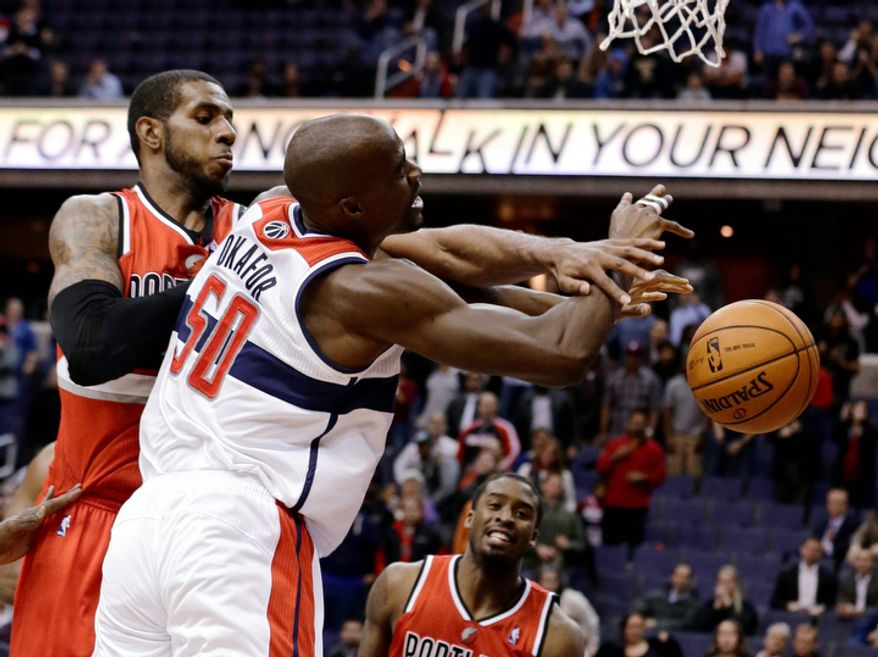 Portland Trail Blazers forward LaMarcus Aldridge fouls Washington Wizards center Emeka Okafor during the second half of an NBA basketball game Wednesday, Nov. 28, 2012, in Washington. Okafor made his two free throws to give the Wizards the 84-82 win, their first victory this season after 12 losses. (AP Photo/Alex Brandon)