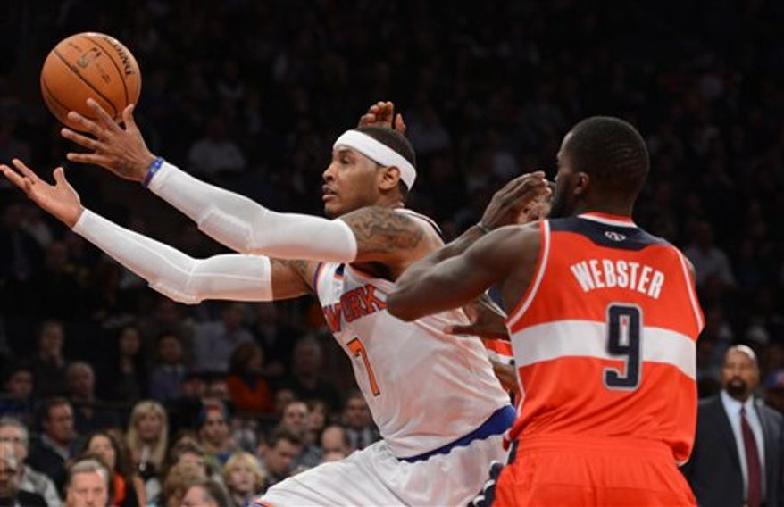 New York Knicks' Carmelo Anthony, left, and Washington Wizards' Martell Webster chase a loose ball in the first quarter of an NBA basketball game at Madison Square Garden in New York, Friday, Nov. 30, 2012. (AP Photo/Henny Ray Abrams)