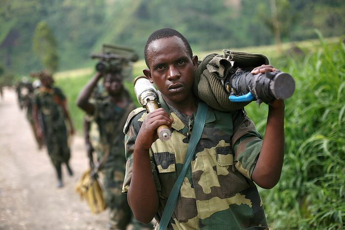M23 rebels  withdraw from the Masisi and Sake areas in the eastern Congo town of Sake, some 27 kms west of Goma, Friday Nov. 30, 2012. Rebels in Congo believed to be backed by Rwanda postponed their departure Friday from the key eastern city of Goma by 48 hours for ìlogistical reasons,î defying for a second time an ultimatum set by neighboring African countries and backed by Western diplomats. The delay raises the possibility that the M23 rebels donít intend to leave the city they seized last week, giving credence to a United Nations Group of Experts report which argues that neighboring Rwanda is using the rebels as a proxy to annex territory in mineral-rich eastern Congo.(AP Photo/Jerome Delay)