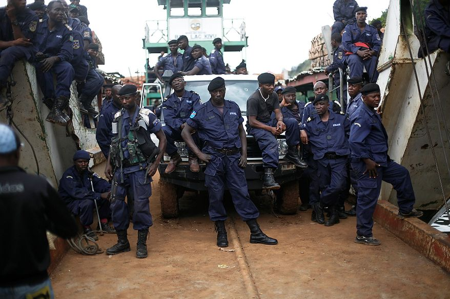 Police Nationale du Congo officers who fled Goma when M23 rebels took over the city Nov. 18, 2012, return on a barge to the port of Goma, eastern Congo, Friday Nov. 30, 2012. The police force were returning to resume control on Friday, as had been agreed by the regional bloc. Rebels in Congo believed to be backed by Rwanda postponed their departure Friday from the key eastern city of Goma by 48 hours for ìlogistical reasons,î defying for a second time an ultimatum set by neighboring African countries and backed by Western diplomats. The delay raises the possibility that the M23 rebels donít intend to leave the city they seized last week, giving credence to a United Nations Group of Experts report which argues that neighboring Rwanda is using the rebels as a proxy to annex territory in mineral-rich eastern Congo.(AP Photo/Jerome Delay)