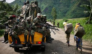 **FILE** M23 rebels withdraw from the Masisi and Sake areas in the eastern Congo town of Sake, some 27 kms west of Goma, on Nov. 30, 2012. (Associated Press)