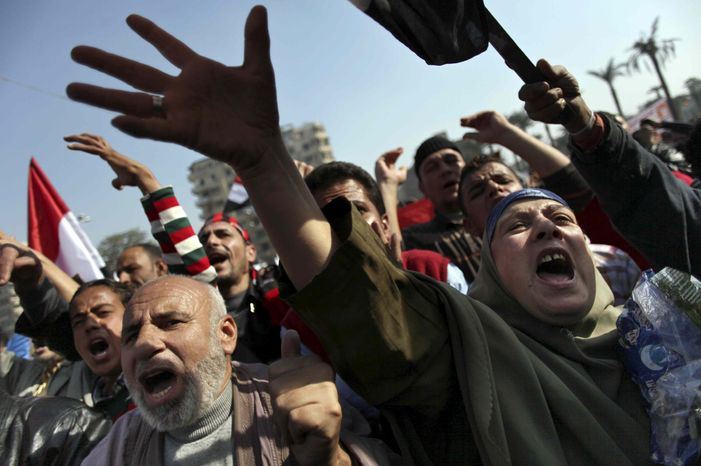 Egyptian protesters chant anti-Muslim Brotherhood slogans as they attend a rally in Tahrir Square, in Cairo, Egypt, Friday, Nov. 30, 2012. (AP Photo/Khalil Hamra)