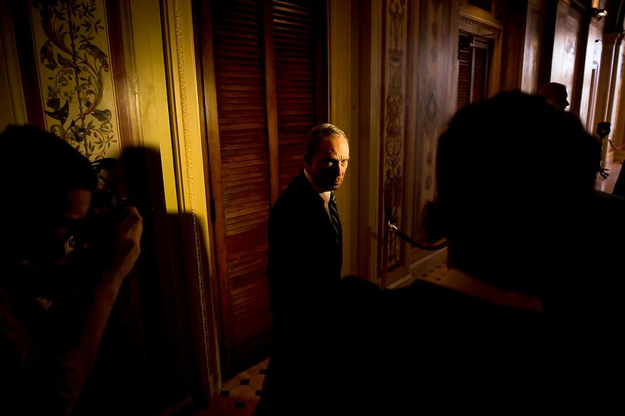 New York Mayor Michael Bloomberg, center, departs from a press conference after discussing New York's request for federal disaster relief at the U.S. Capitol Building, Washington, D.C., Wednesday, November 28, 2012. (Andrew Harnik/The Washington Times)