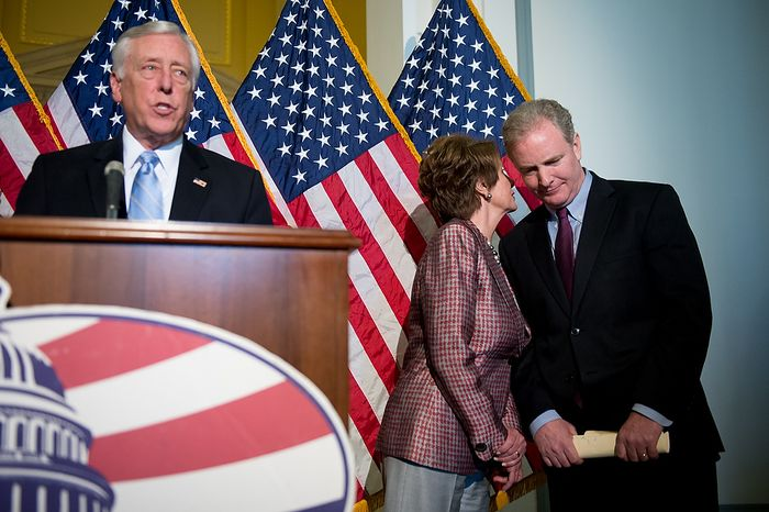 House Minority Leader Nancy Pelosi (D-Calif.), second from right, whispers with Rep. Chris Van Hollen (D-Md.), right, as House Minority Whip Steny Hoyer (D-Md.), speaks at a press conference announcing leadership positions for the 113th Congress outside the 113th Congress democratic Caucus Organizational meeting in the cannon office building, Washington, D.C., Thursday, November 29, 2012. (Andrew Harnik/The Washington Times)