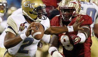 Georgia Tech's Vad Lee (2) tries to scrambles away from Florida State's Timmy Jernigan (8) during the first half of the ACC Championship college football game in Charlotte, N.C., Saturday, Dec. 1, 2012. Lee was sacked on the play. (AP Photo/Chuck Burton)