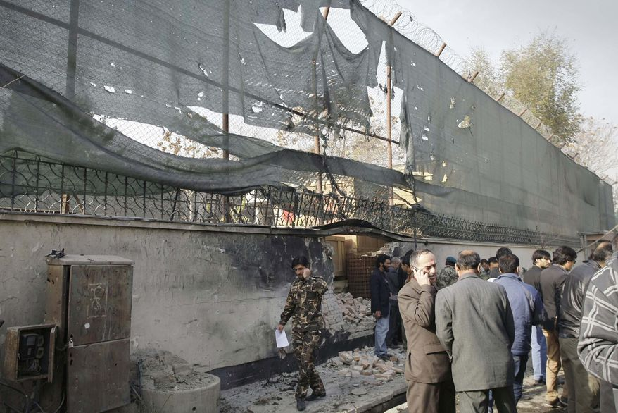 ** FILE ** Afghan security men and media members gather at the scene of a suicide attack in Kabul, Afghanistan, Wednesday, Nov. 21, 2012. (AP Photo/Musadeq Sadeq)