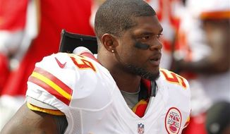 ** FILE ** In this Sept. 16, 2012, file photo, Kansas City Chiefs' Jovan Belcher (59) stands on the sidelines during an NFL football game against the Buffalo Bills in Orchard Park, N.Y. Police say Belcher fatally shot his girlfriend early Saturday, Dec. 1, 2012, in Kansas City, Mo., then drove to Arrowhead Stadium and committed suicide in front of his coach and general manager. (AP Photo/Bill Wippert, File)