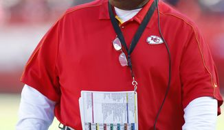 **FILE** Kansas City Chiefs coach Romeo Crennel looks at the clock during the first half of the Chiefs' 17-9 loss to the Denver Broncos at Arrowhead Stadium in Kansas City, Mo., on Nov. 25, 2012. (Associated Press)