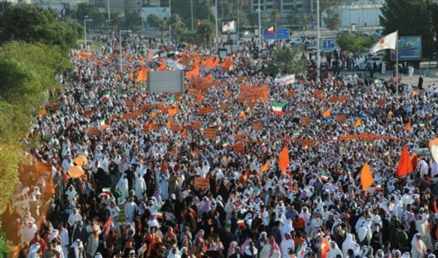 Islamist, nationalist and liberal opposition groups gather to protest the Kuwait government's amendment of the electoral law and support a boycott on the country's election on Friday, Nov. 30, 2012, in Kuwait City. (AP Photo/Gustavo Ferrari)