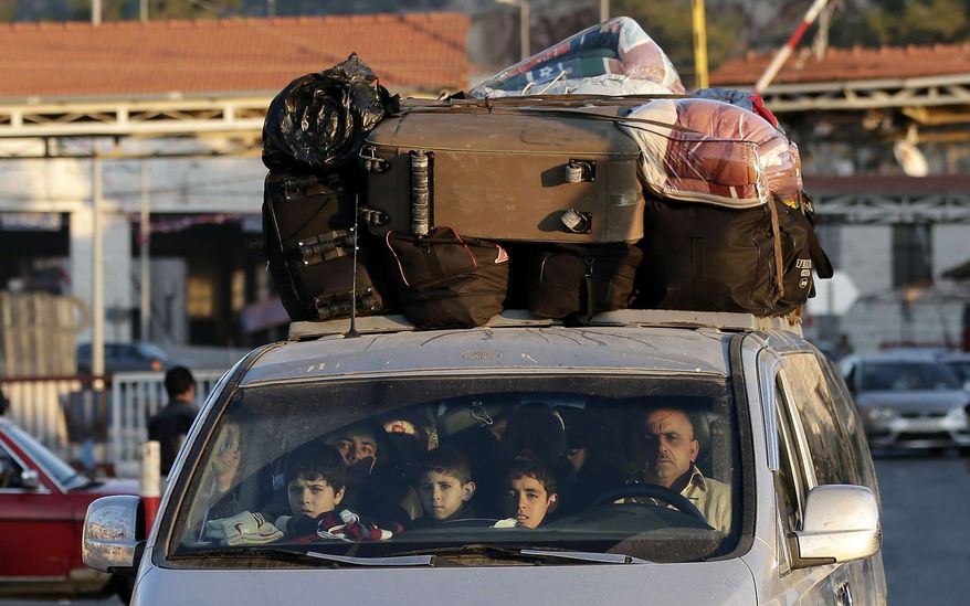 A Syrian family crosses into Lebanon at the border crossing in Masnaa, eastern Lebanon, Friday, Nov. 30, 2012. (AP Photo/Hassan Ammar)