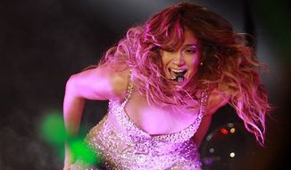 ** FILE ** In this Nov. 24, 2012, file photo, Jennifer Lopez performs during her concert in Shanghai, China. Lopez wowed thousands of fans in Indonesia on Friday, Nov. 30, 2012, but they didn't see as much of her as concertgoers in other countries. (AP Photo/Eugene Hoshiko, File)