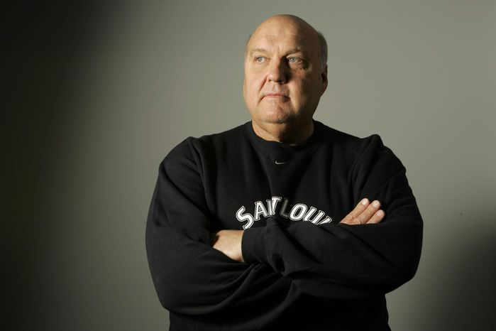 ** FILE ** In this Oct. 30, 2007, file photo, St. Louis basketball coach Rick Majerus poses for a photo in St. Louis. Majerus, the jovial college basketball coach who led Utah to the 1998 NCAA final and had only one losing season in 25 years with four schools, died Saturday, Dec. 1, 2012. He was 64. (AP Photo/Jeff Roberson, File)
