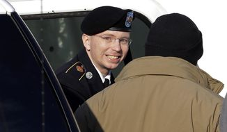 ** FILE ** Army Pfc. Bradley Manning (center) steps out of a security vehicle as he is escorted into a courthouse at Fort Meade, Md., for a pretrial hearing on Wednesday, Nov. 28, 2012. (AP Photo/Patrick Semansky)
