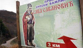 "In this Nov. 30, 2012, photo a billboard showing an impression of the legendary ghost Sava Savanovic. The poster reads ""First Serbian vampire"", near the village of Zarozje, near the Serbian town of Bajina Basta. (AP Photo/Darko Vojinovic)"