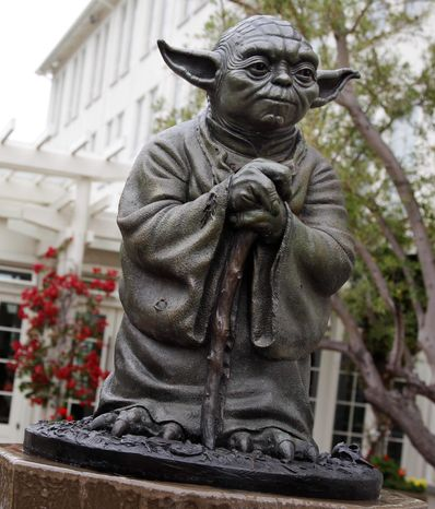 Filmmaker George Lucas said he is moving forward with plans to build a park complete with a statue of Yoda and Indiana Jones in his Marin County hometown of San Anselmo, Calif. (Associated Press)