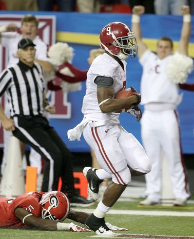 Alabama wide receiver Amari Cooper runs into the end zone as Georgia defensive back Damian Swann comes up empty on his diving tackle attempt in the SEC championship Saturday. The Crimson Tide won 32-28. (Associated Press)