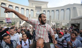 A demonstrator chants slogans as several thousand supporters of Islamist President Mohammed Morsi surround the Supreme Constitutional Court on Sunday, Dec. 2, 2012, to prevent the judges from entering and ruling on the legitimacy of the nation's Islamist-dominated constituent assembly. (AP Photo/Ahmad Hammad)