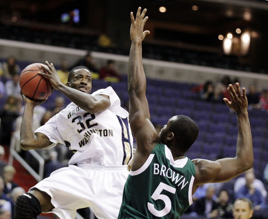 George Washington's Isaiah Armwood (32) shoots against Manhattan's Rhamel Brown (5) during the second half of an NCAA college basketball game at the BB&T Classic in Washington, Sunday, Dec. 2, 2012. George Washington won 67-55. (AP Photo/Luis M. Alvarez)