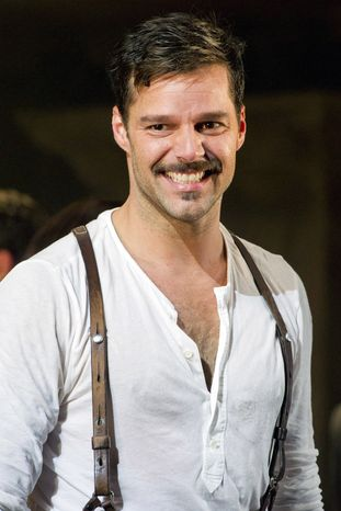 "Ricky Martin appears at the curtain call after his first performance in the new Broadway revival of ""Evita"" in New York on Monday, March 12, 2012. (AP Photo/Charles Sykes)"
