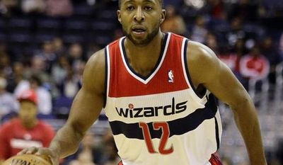 Washington Wizards point guard A.J. Price (12) dribbles the ball in the first half of an NBA basketball game against the San Antonio Spurs Monday, Nov. 26, 2012, in Washington.(AP Photo/Alex Brandon)