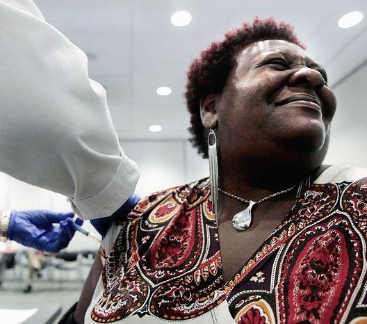 Elizabeth Saint Victor winces earlier this year as she gets a flu shot in Memphis, Tenn. (Associated Press)
