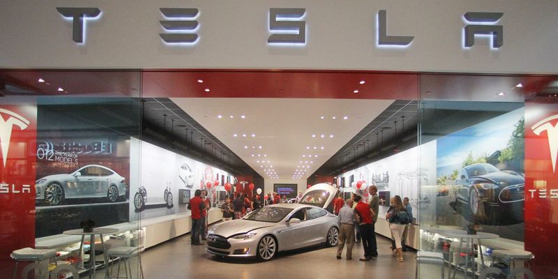 Tesla Motors has 24 stores in the world, including this one at a mall in Portland, Ore. It received a $465 million loan from the U.S. Department of Energy, and President Obama has praised the company. (Associated Press)
