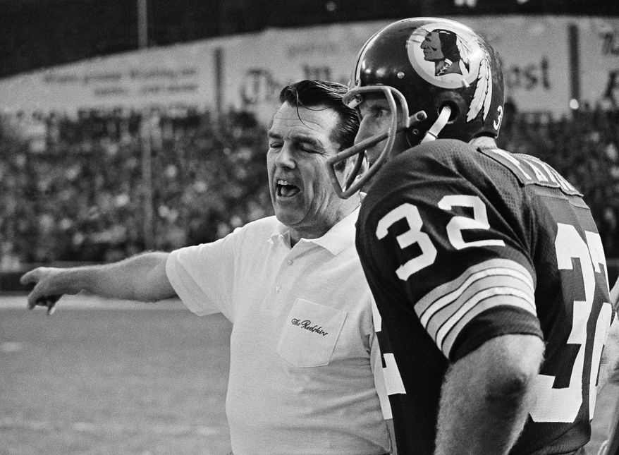 Defense-minded Washington Redskins' coach George Allen is shown conferring with his defensive leader linebacker Jack Pardee. Allen leads the NFC champion Skins against the Miami Dolphins, AFC champion team, in the super bowl in Los Angeles, Jan. 6, 1973. (AP Photo)
