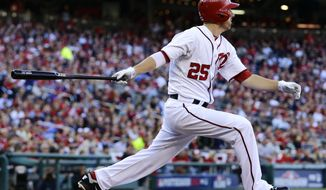 Washington Nationals' Adam LaRoche watches his solo home run in the second inning of Game 4 of the National League division baseball series against the St. Louis Cardinals on Thursday, Oct. 11, 2012, in Washington. (AP Photo/Alex Brandon)