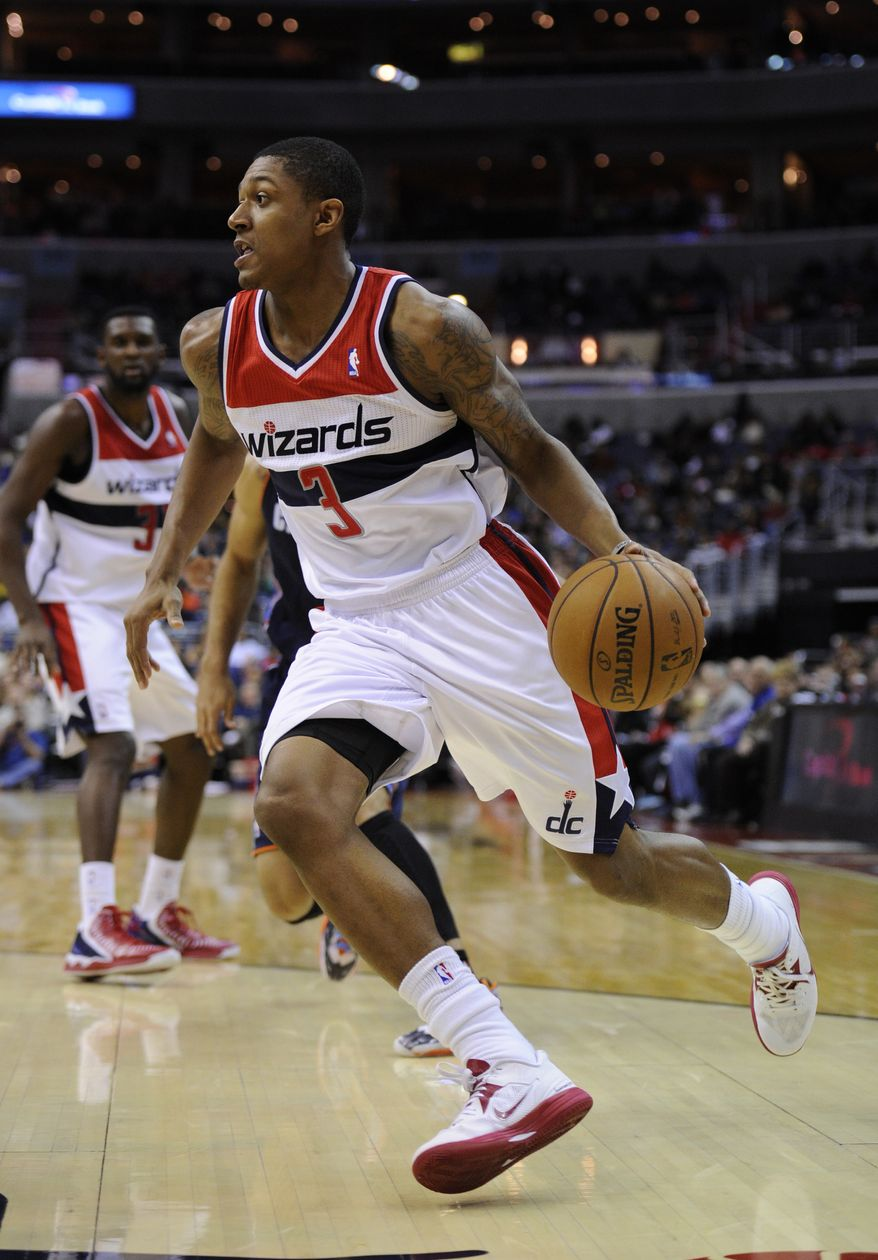 Washington Wizards shooting guard Bradley Beal (3) dribbles against the Charlotte Bobcats during the second half of an NBA basketball game, Saturday, Nov. 24, 2012, in Washington. Charlotte won 108-106 in double overtime. (AP Photo/Nick Wass)