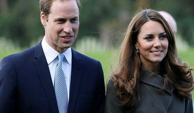 **FILE** Britain's Prince William (left) and his wife Kate, the Duchess of Cambridge, visit a football training pitch at St George's Park near Burton Upon Trent in Staffordshire, England, on Oct. 9, 2012. (Associated Press)