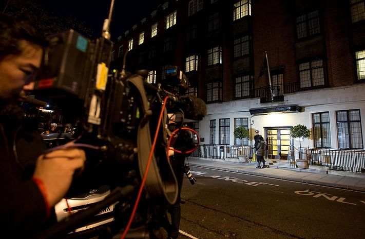 Members of the media position themselves as a policeman stands guard Dec. 3, 2012, outside the King Edward VII hospital in London, where the Duchess of Cambridge has been admitted with a severe form of morning sickness. Prince William and his wife Kate are expecting their first child. (Associated Press)