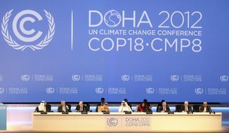 Organizers sit onstage during the opening ceremony of the 18th United Nations climate change conference in Doha, Qatar, on Monday, Nov. 26, 2012. (AP Photo/Osama Faisal)