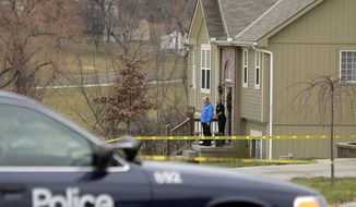 Investigators stand outside an Independence, Mo., house where, police say, Kansas City Chiefs linebacker Jovan Belcher fatally shot his girlfriend before driving to the NFL football team's training facility and shooting himself on Saturday, Dec. 1, 2012. (AP Photo/Charlie Riedel)